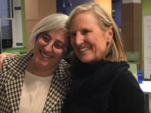 Suzanne Schutte and Executive Director Olken smile together at an event