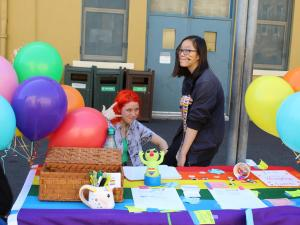 Students man a table for the GSA at Club Day